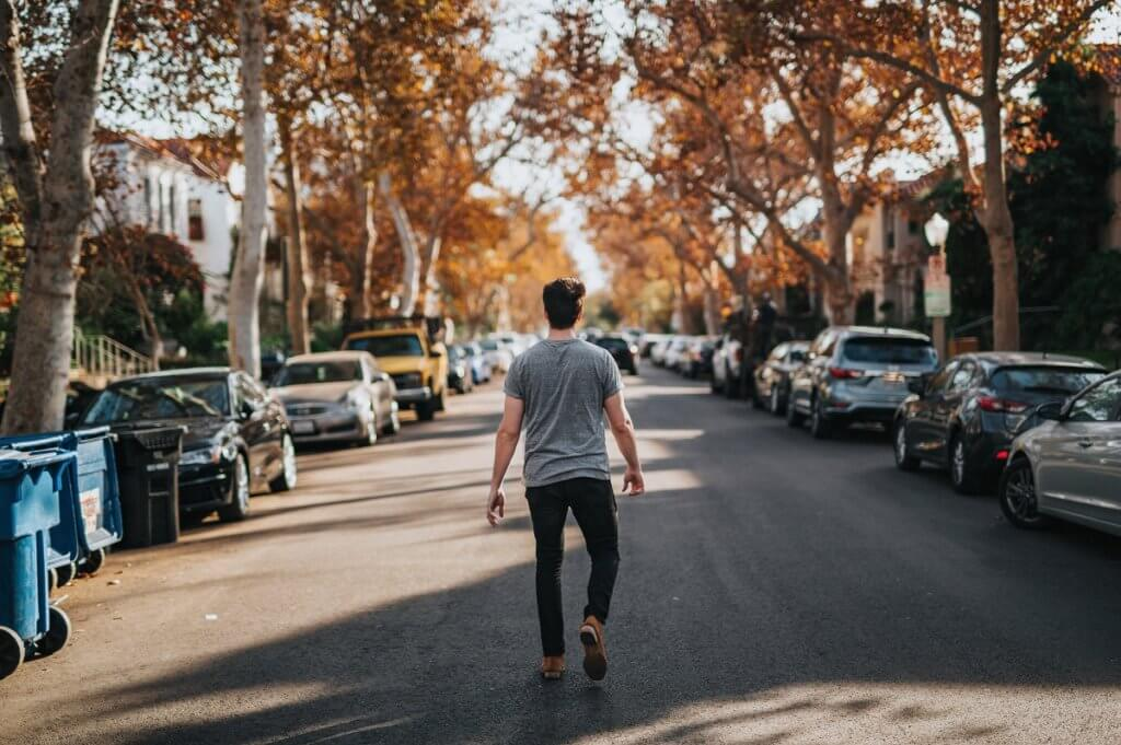 a man walking along a city street