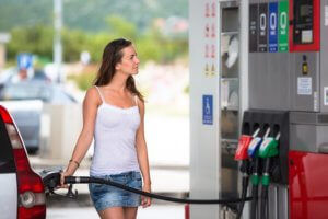 Woman saving money on gas buying it at lowest price.