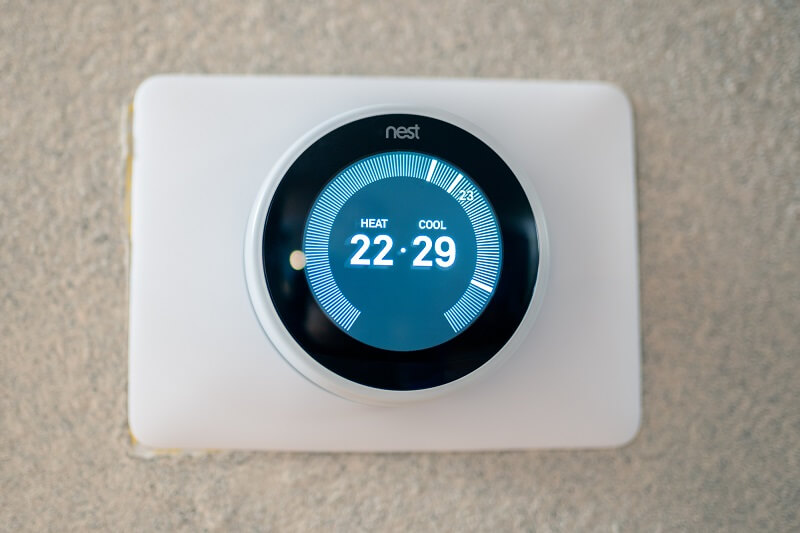 A programmable thermostat being used to save money on heating