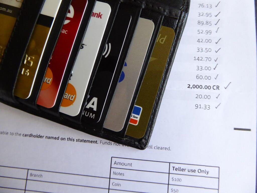 a wallet sits with bills waiting to be paid