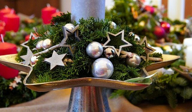 home made holiday decor of stars and silver balls on cedar boughs