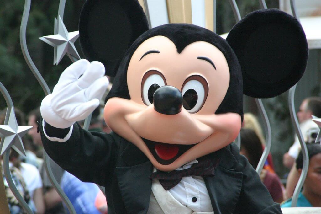 Mickey Mouse waving to children