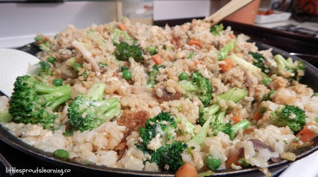 cooked chicken fried rice in a platter