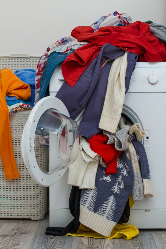Letting laundry pile up is one of the common laundry mistakes.