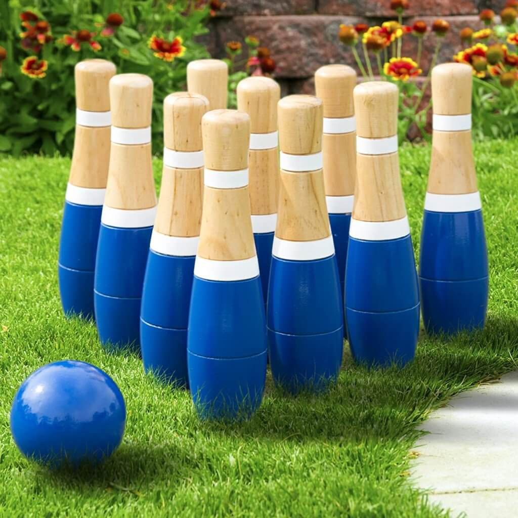 a game of lawn bowling set up in the backyard