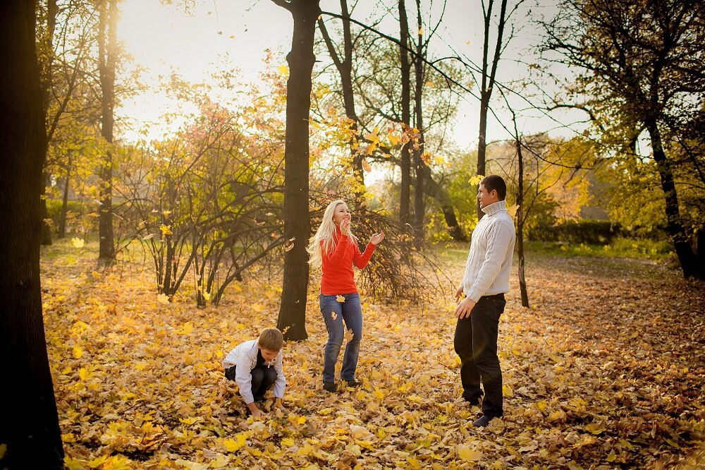 family having fun in the Fall leaves