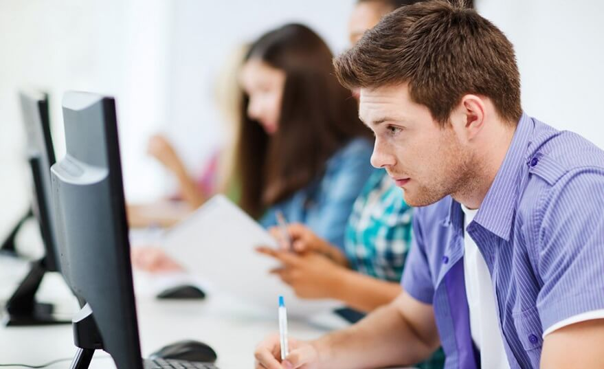Teen learning coding online