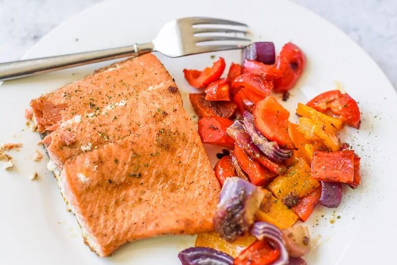 Salmon peppers and tomatoes on a plate