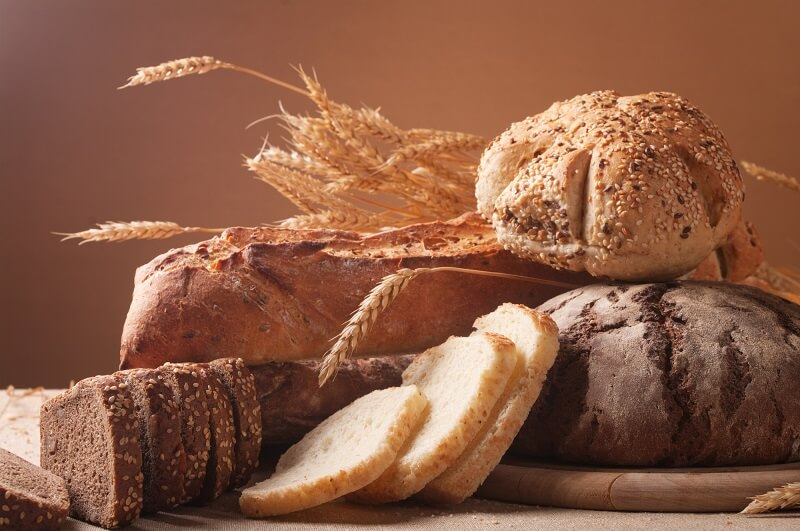 different kinds of bread on a cutting board
