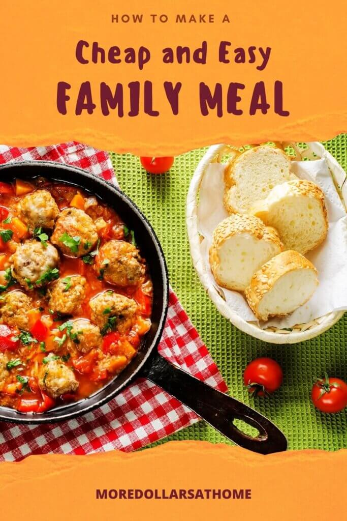 Meatballs, vegetables and tomato sauce in a skillet alongside bread in a basket