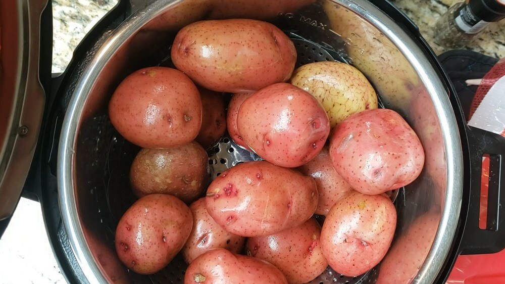 scrubbed potatoes ready for cooking